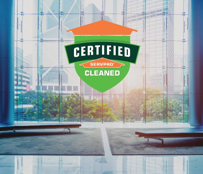 Certified: SERVPRO Cleaned logo on a window